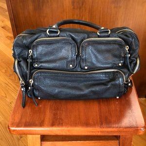 Kate Spade black tote handbag.